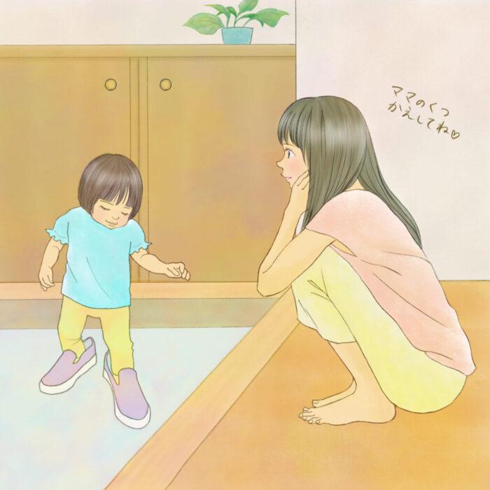 ママの靴を履いている子供